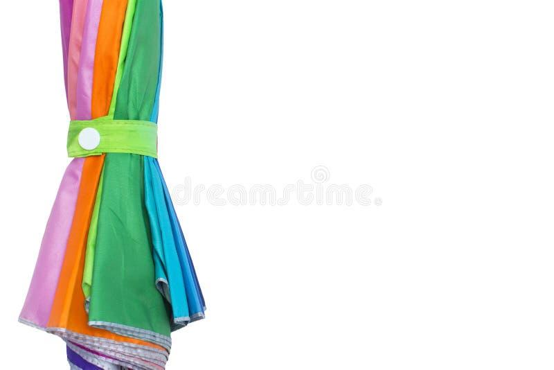 Paraplyer vikta på en vit bakgrund royaltyfri fotografi