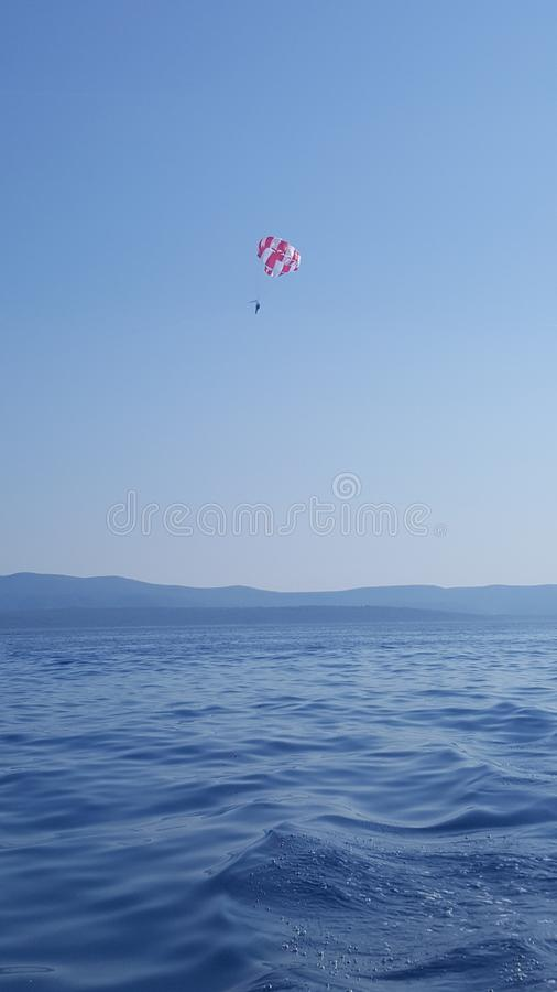 Parasailing in the Adriatic coast in Croatia, Southern Europe - recreational kiting activity royalty free stock images