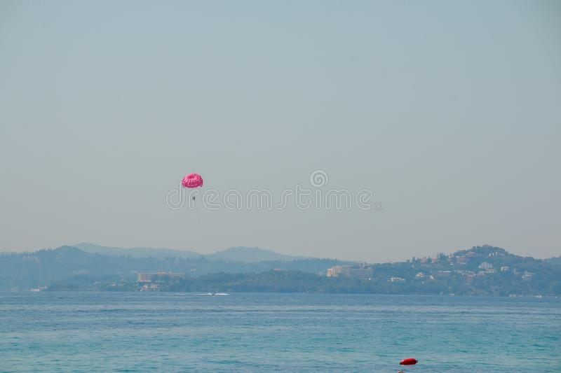 Parasailing at Beach in Europe, extreme Sport. Tourists parasailing, popular entertainment for holiday travelers on sea. Parasailing extreme Sport. Tourists stock image