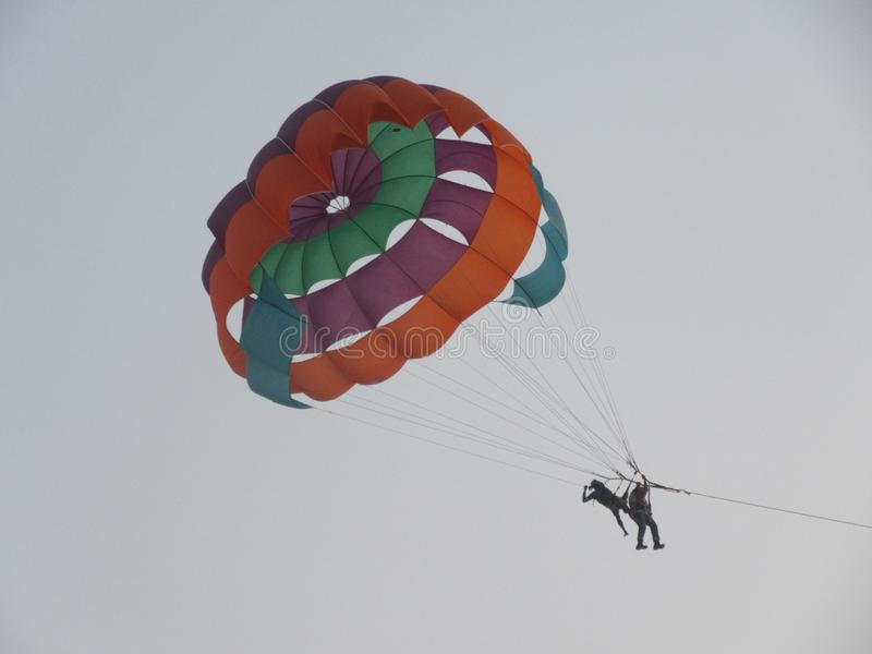 Parasailing at the coast and beaches of Goa in South India royalty free stock images