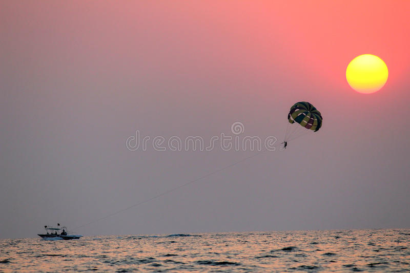 Parasailing at the colva beach in Goa India. Goa is a famous tourist destination in india famous for its beaches and scenic beauty stock images