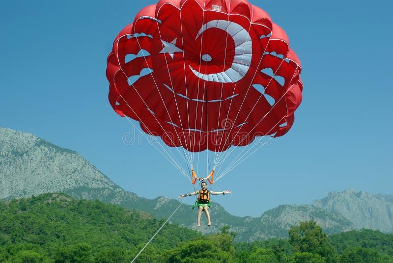 Parasailing parachute, sea and good mood stock photos
