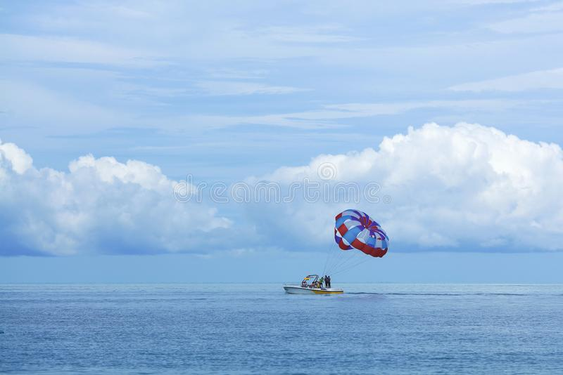 Parasailing is a popular pastime in many resorts around the world. The active form of relaxation. Focus on a parachute. Parasailing is a popular pas in many stock images