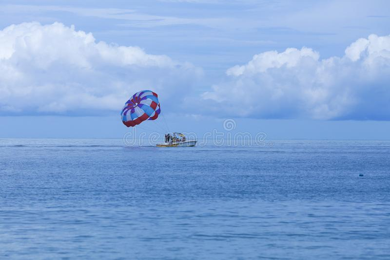 Parasailing is a popular pastime in many resorts around the world. The active form of relaxation. Focus on a parachute. Parasailing is a popular pas in many royalty free stock photography