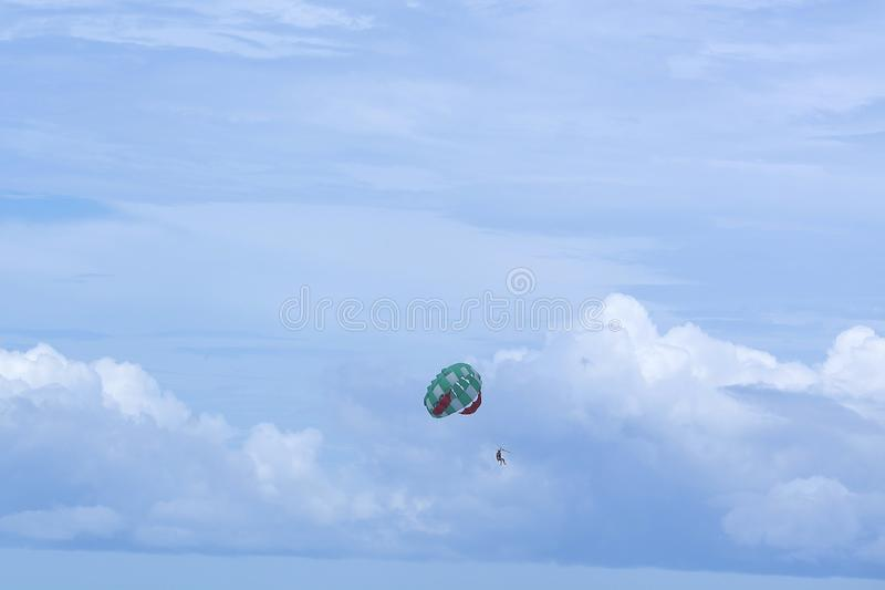 Parasailing is a popular pastime in many resorts around the world. The active form of relaxation. Focus on a parachute. Parasailing is a popular pastime in many royalty free stock photo