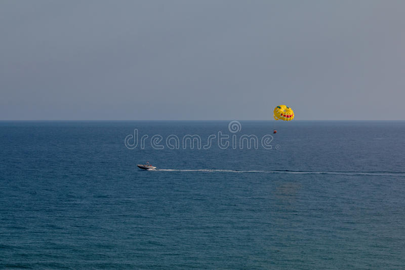 Parasailing is a popular pastime in many resorts around the world. The active form of relaxation.  royalty free stock photography