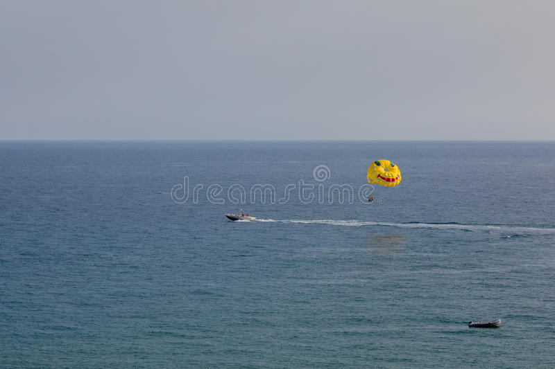 Parasailing is a popular pastime in many resorts around the world. The active form of relaxation.  stock photography