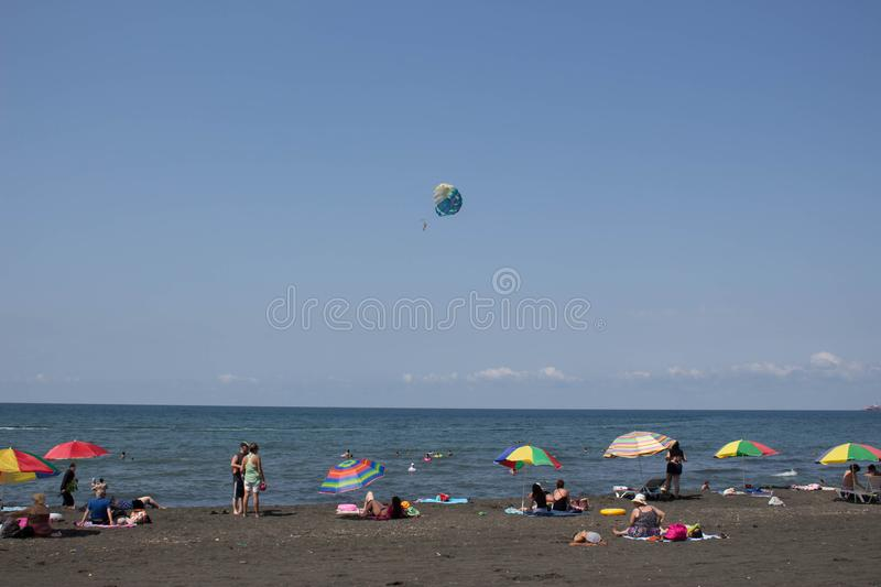 Parasailing is a popular pastime in many resorts around the world. The active form of relaxation. Beach life, holidaymaker at the beach of the image desired blur royalty free stock photo