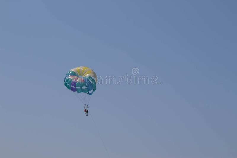 Parasailing is a popular pastime in many resorts around the world. The active form of relaxation. Travel or sea vacations concept royalty free stock photos