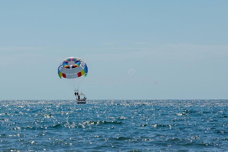 Parasailing at sea boat parachute outdoor activities stock photo