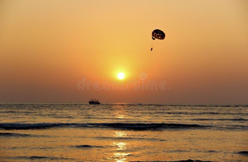 Parasailing at sunset royalty free stock photo