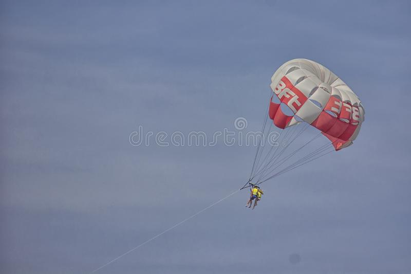Parasailing together high in the blue sky stock image