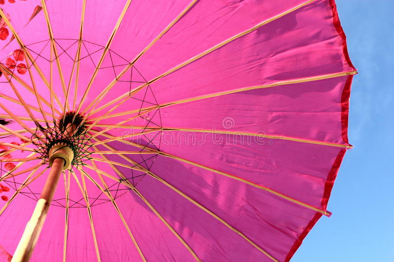 Parasol. Bright pink parasol on a sunny day stock photography