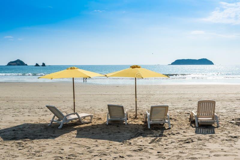 Parasol with chairs at Playa Espadilla at Manuel Antonio Park - Costa Rica stock photos