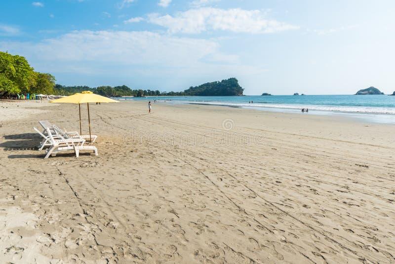 Parasol with chairs at Playa Espadilla at Manuel Antonio Park - Costa Rica royalty free stock image