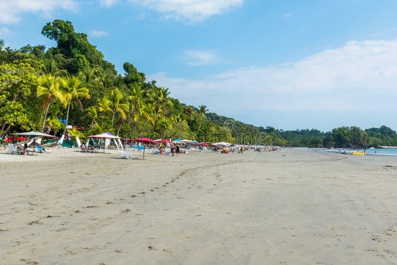 Parasol with chairs at Playa Espadilla at Manuel Antonio Park - Costa Rica royalty free stock photo