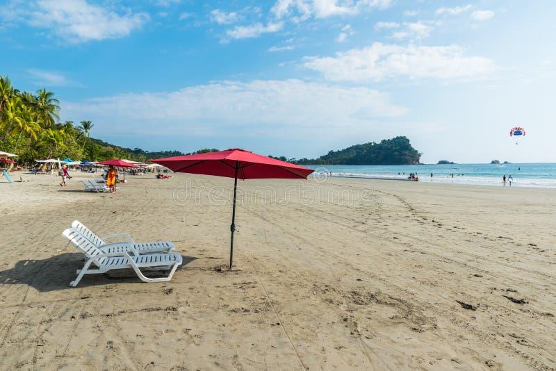 Parasol with chairs at Playa Espadilla at Manuel Antonio Park - Costa Rica royalty free stock photos