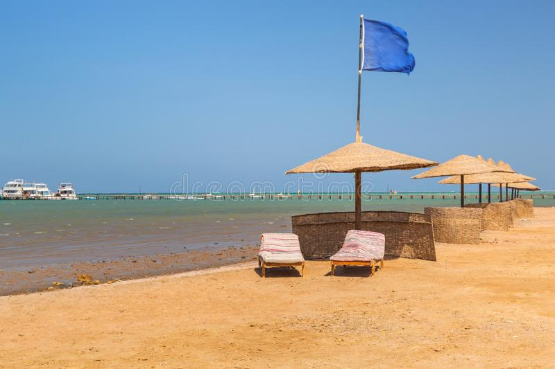 Parasols on the beach of Red Sea in Hurghada royalty free stock photography