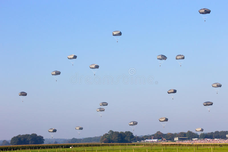 Paratroopers. GROESBEEK, NETHERLANDS - SEP 18: Paratroopers from the 82nd Airborne Division land near Groesbeek during the Market Garden memorial. Market Garden royalty free stock photography