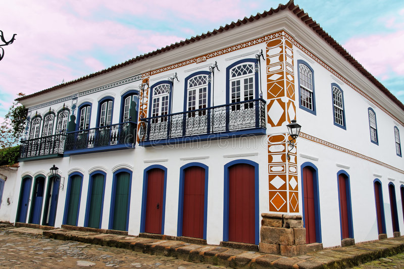 Paraty Historical Buildings Rio de Janeiro. A typical portuguese colonial style colorful building on the corner of a stone street in the historical downtown of royalty free stock photo