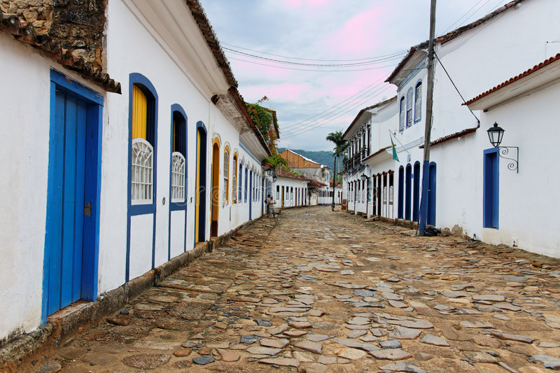 Paraty Historical Housing Rio de Janeiro. The historical colonial portuguese style housing with blue and yellow wood windows and door at a typical stone street royalty free stock images