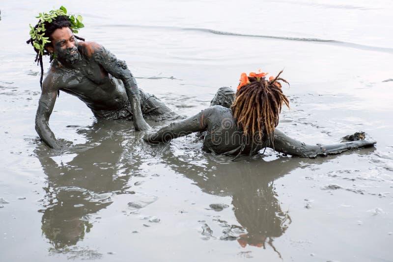 Bloco da Lama – Dirty Carnival in Paraty, Rio de Janeiro State. Paraty, Rio de Janeiro State, Brazil – February 25, 2017: Clad in swimwear and rags stock images