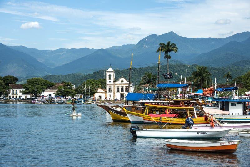 Paraty, state Rio de Janeiro, Brazil. RIO DE JANEIRO, FEBRUARY, 15, 2016 - Tourist boats waiting for tourists near the Church Igreja de Santa Rita de Cassia in