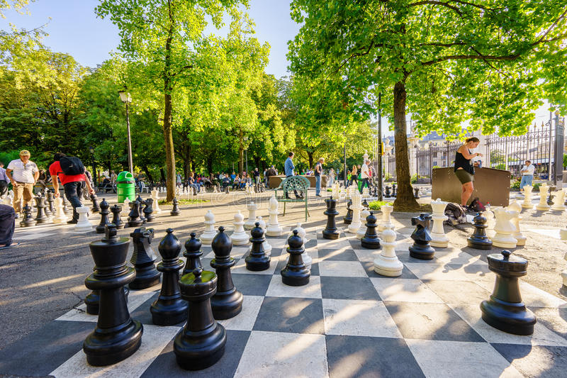 Parc des Bastions in Geneva, Switzerland - HDR. Black and white outdoors chess game in Parc des Bastions, Geneva, Switzerland. Photo taken on: August 25, 2015 royalty free stock photo