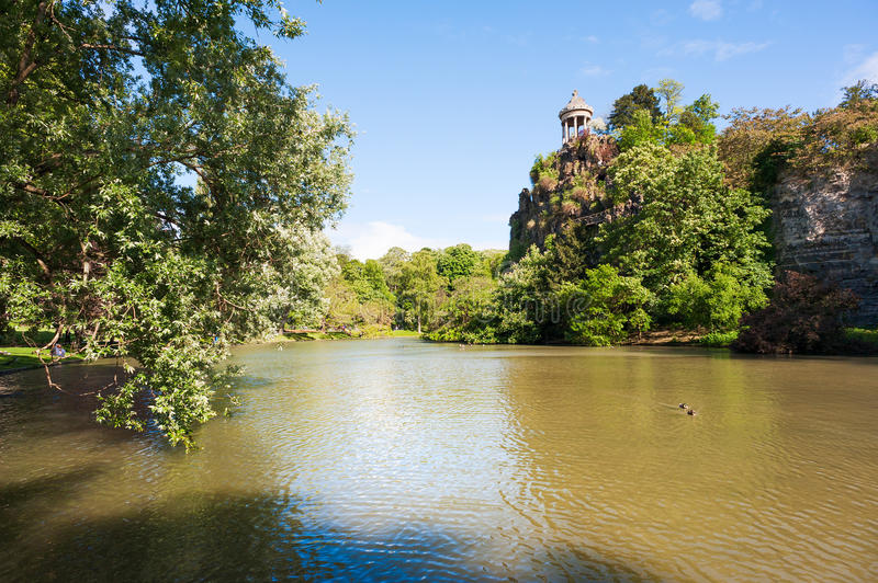 Parc des buttes Chaumont lake on a sunny day. France stock photos