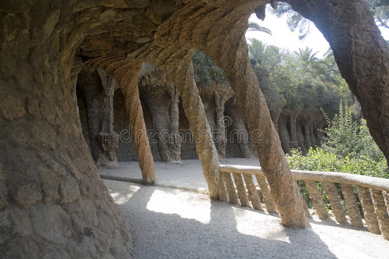 Parc Guell, Barcelona. Shady arcade made of twisted stone shapes, by Gaudi stock photography