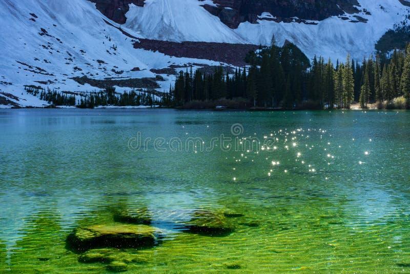 Parc national caché de scintillement de glacier de lac images stock
