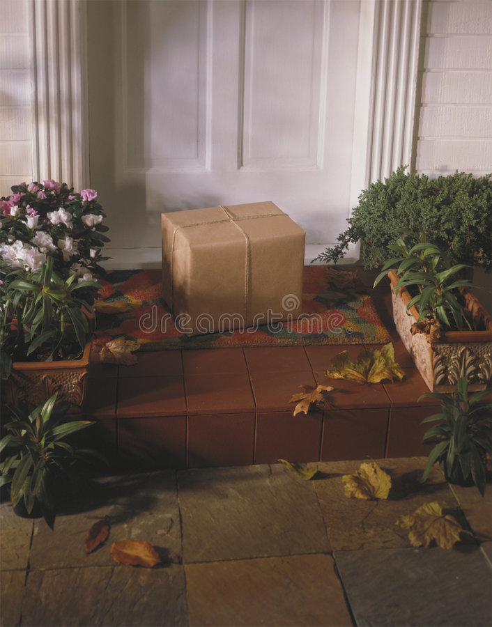 Parcel on front steps of house stock image