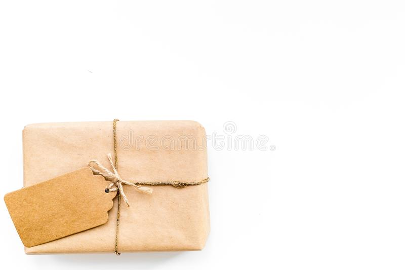 Parcel packaging box wrapped with craft paper with empty label mockup on whitebackground top view copy space stock image