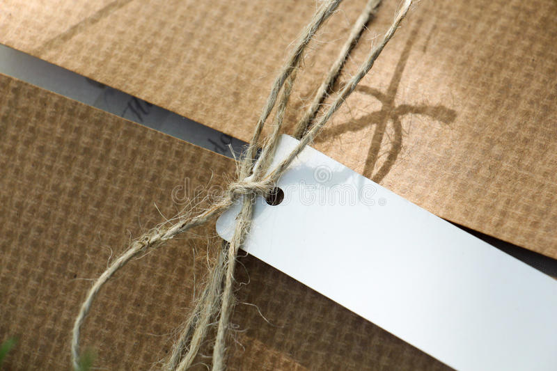Parcel tied with label stock photography