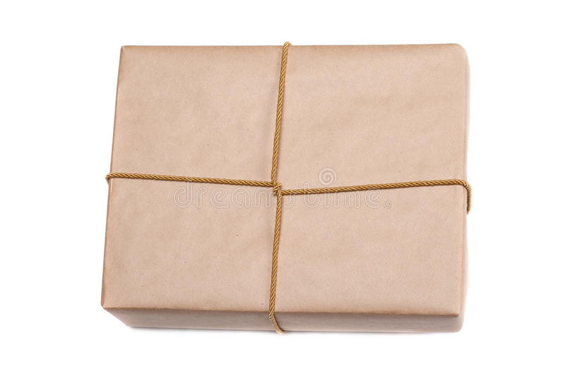 parcel wrapped with brown kraft paper isolated on white background royalty free stock photography
