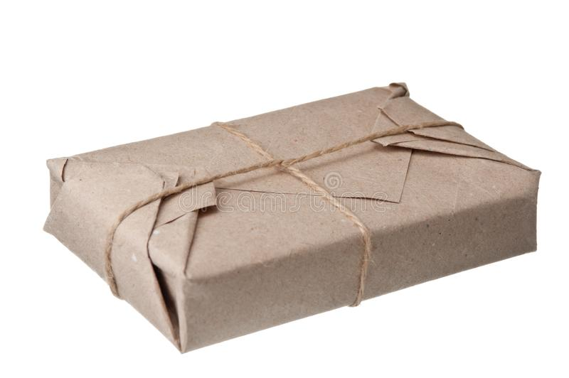 Parcel wrapped with brown kraft paper. Isolated on white background royalty free stock images