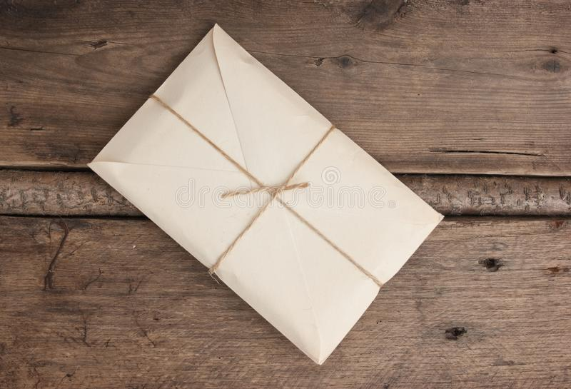 Parcel wrapped. With brown kraft paper and tied with twine royalty free stock photo