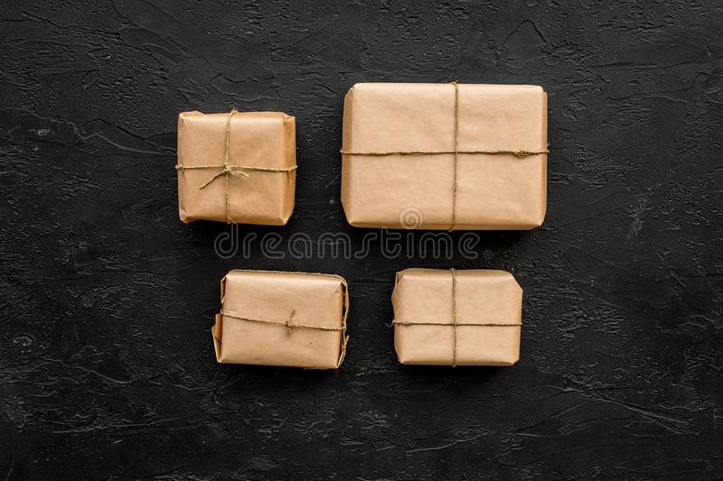 Parcels box in delivery service office black background top view space for text stock images