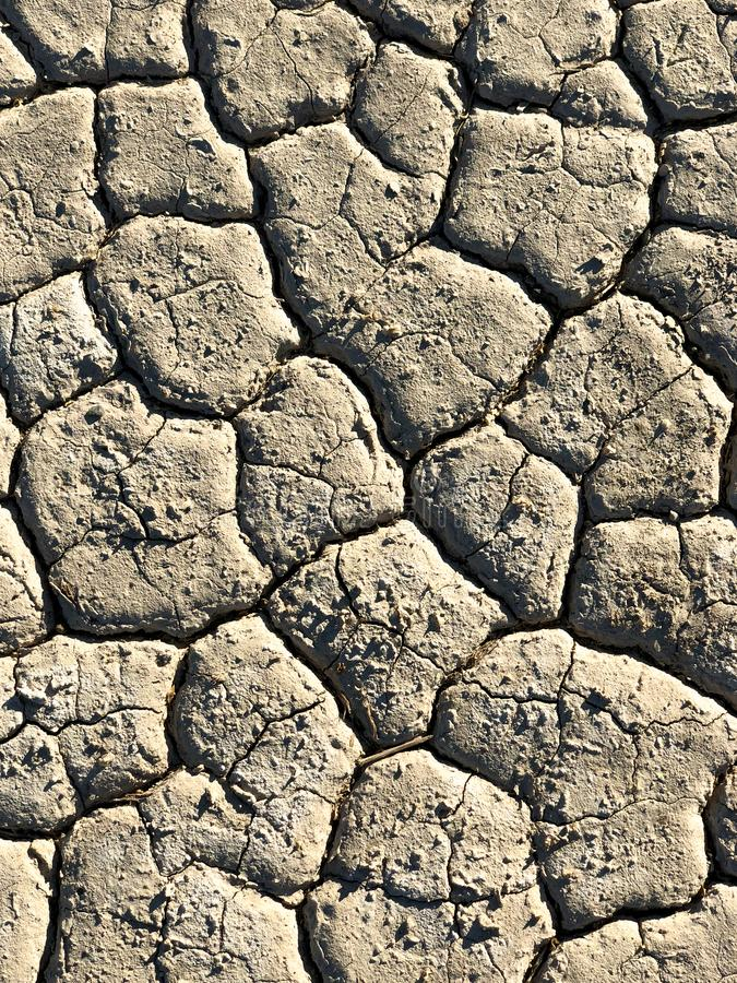 Parched and thirsty earth shot from above. An overhead shot of parched and thirsty earth in a desert scene royalty free stock photos
