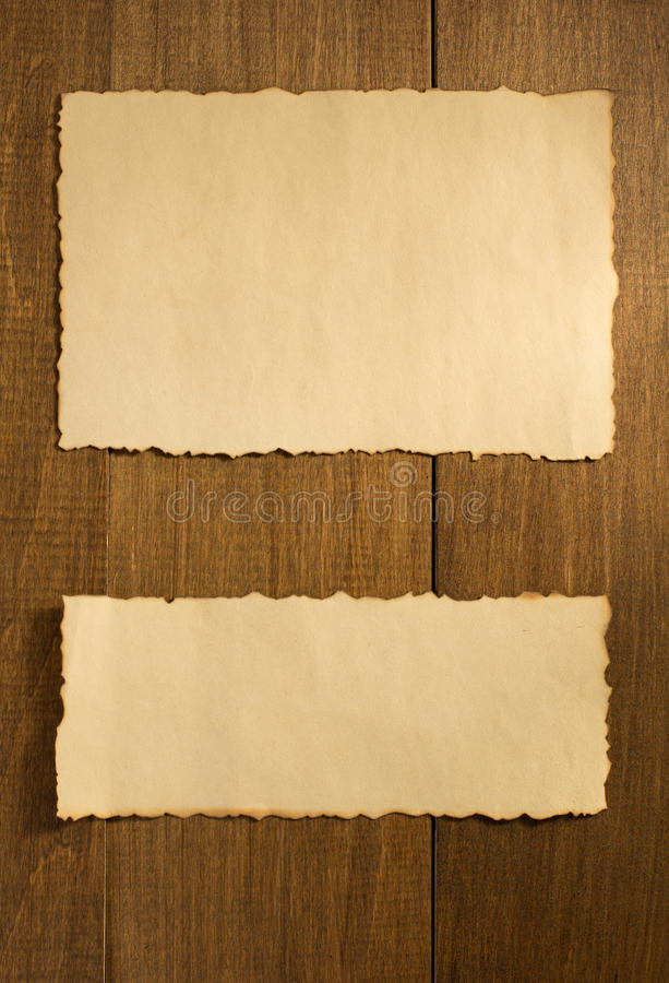 Parchment paper on wood. Parchment old paper on wooden background royalty free stock photos