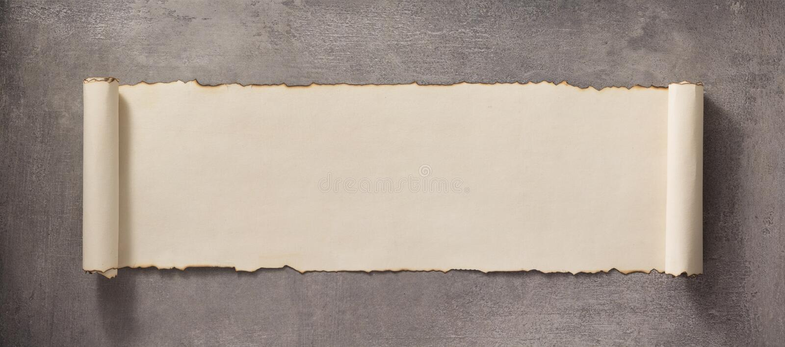Parchment scroll at concrete surface royalty free stock photo