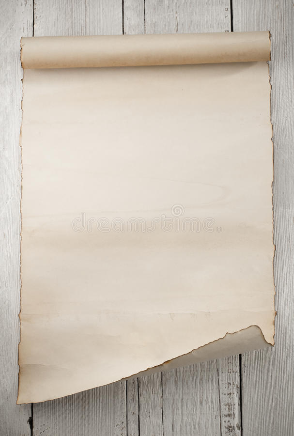 Parchment scroll on wood. En background royalty free stock photos