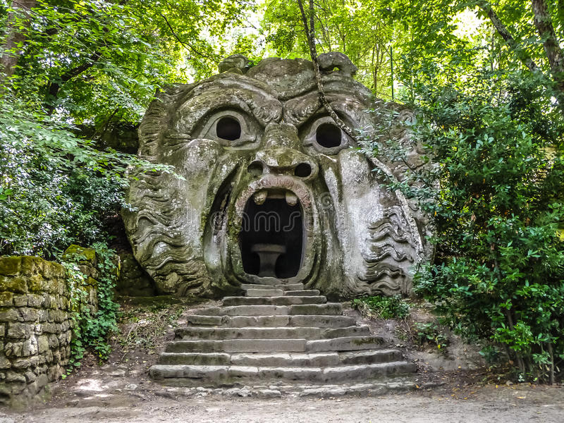 Parco dei Mostri in Bomarzo, province of Viterbo, Lazio, Italy. Orcus mouth sculpture at famous Parco dei Mostri (Park of the Monsters), also named Sacro Bosco ( royalty free stock images