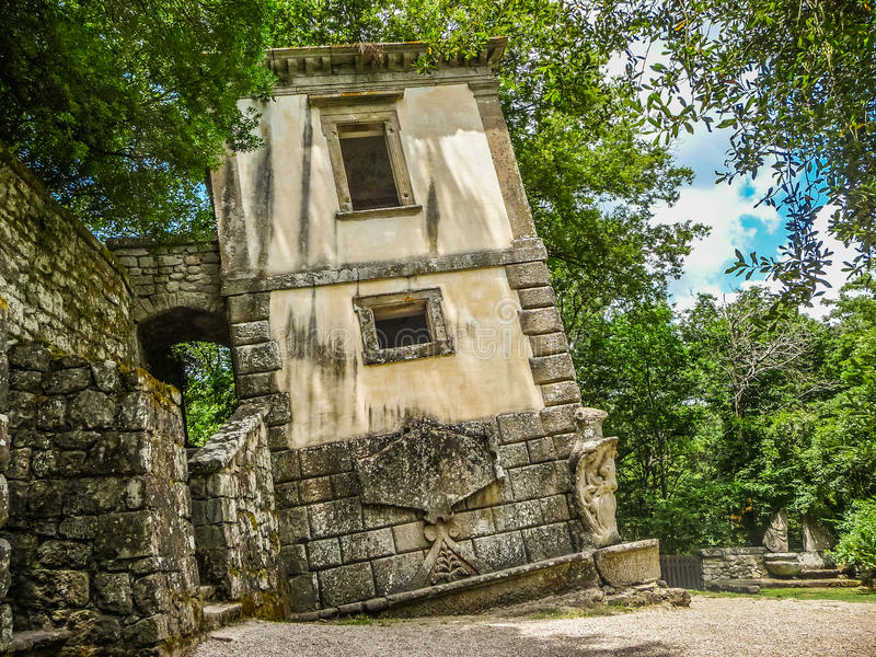Parco dei Mostri (Park of the Monsters) in Bomarzo, province of Viterbo, northern Lazio, Italy. Crooked building at famous Parco dei Mostri (Park of the Monsters royalty free stock image