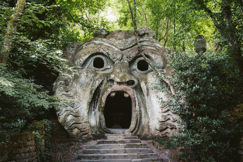 Parco dei Mostri Park of the Monsters in Bomarzo, province of Viterbo, Lazio, Italy. Orcus mouth sculpture at famous Parco dei Mostri Park of the Monsters, also stock photo