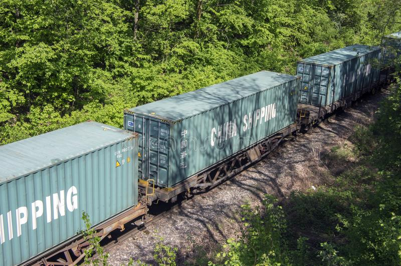 Pardubice Cerna za Bory, Czech republic / April 28, 2018 - Cargo train with China Shipping waggon containers run on the track. In countryside royalty free stock photography