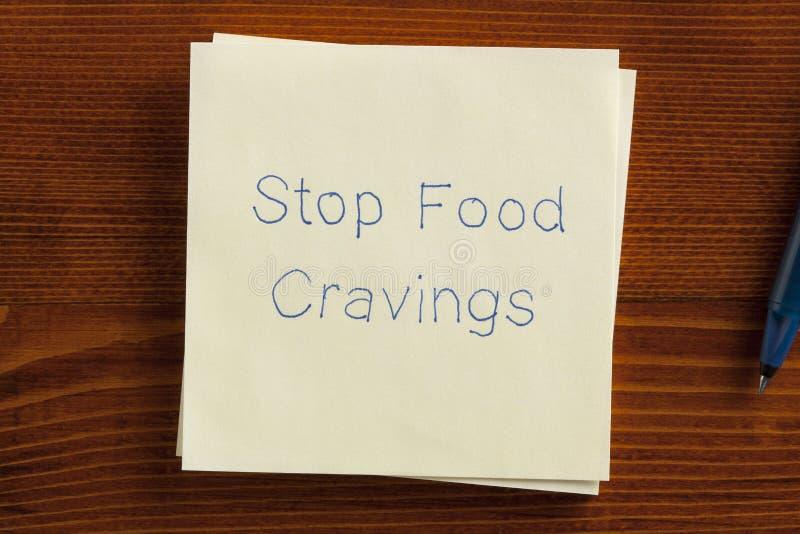 Pare ânsias do alimento em uma nota foto de stock royalty free