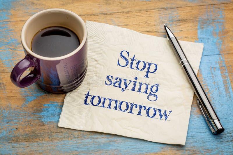 Pare el decir mañana del texto de motivación imagen de archivo libre de regalías