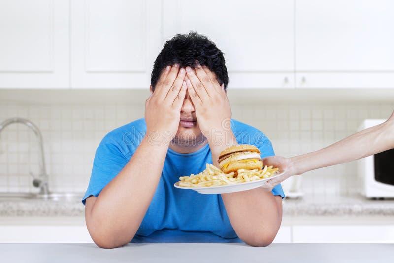 Pare para comer a comida lixo 1 foto de stock
