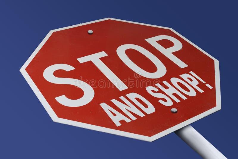 Pare y haga compras fotos de archivo